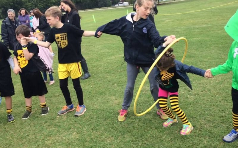 cub scout play hula hoop relay games